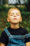 Portrait de garçon de sourire de sept ans Garçon de sept ans avec Images stock