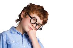 Portrait de garçon réfléchi beau dans rond Photographie stock libre de droits