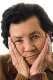 Portrait de grand-mère regardant nostalgique Photos libres de droits