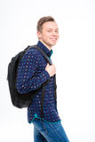 Portrait de jeune étudiant blond heureux cheeful avec le sac à dos Photos libres de droits