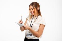 Portrait de jeune femme d'affaires réussie au-dessus du fond blanc Image stock