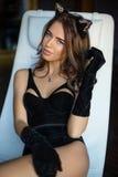 Portrait de jeune fille sexy dans le corset avec des oreilles de chat Images stock