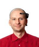 Portrait de jeune homme avec le casque d'EEG sur la tête Photo libre de droits