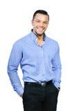 Portrait de jeune homme de sourire heureux d'affaires, d'isolement au-dessus du petit morceau Photos stock