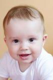 Portrait de l'âge de sourire de bébé de 7 mois Photos stock