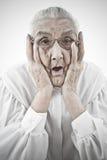 Grand-maman avec la bouche ouverte Images stock