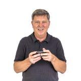 Portrait de l'homme employant au téléphone portable Photo libre de droits