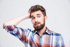 Portrait de l'homme stupéfait regardant l'appareil-photo Photographie stock