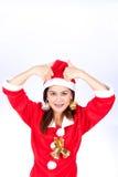 Portrait de la belle fille asiatique portant la fille de Santa Claus avec a Photos libres de droits