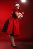 Portrait de Noël de beau plus la jeune femme de taille Photographie stock