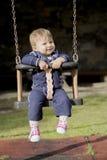 Portrait de petit bébé heureux sur l'oscillation Photographie stock libre de droits
