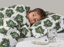 Portrait de petit garçon malade Photographie stock libre de droits