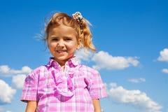 Portrait de petite fille dans le rose Photographie stock