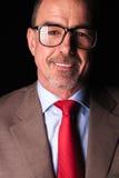 Portrait de plan rapproché d'un sourire d'homme d'affaires mûres Photos stock