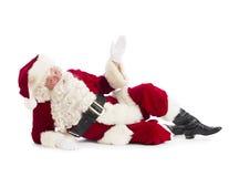 Portrait de plancher de Santa Claus Gesturing While Lying On photos stock