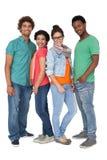 Portrait de quatre jeunes amis heureux Photos libres de droits