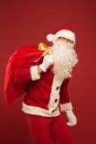 Portrait de Santa Claus heureuse avec un sac énorme Image libre de droits
