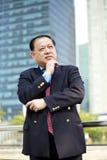 Portrait de sourire d'homme d'affaires asiatique supérieur Photos stock