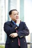 Portrait de sourire d'homme d'affaires asiatique supérieur Photo libre de droits