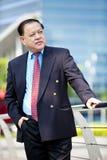 Portrait de sourire d'homme d'affaires asiatique supérieur Photographie stock libre de droits