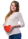 Portrait de studio de belle jeune femme enceinte Photo libre de droits