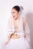 Portrait de studio de belle jeune mariée fâchée Photo libre de droits