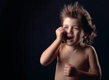 Portrait de studio de pleurer adorable d'enfant photographie stock