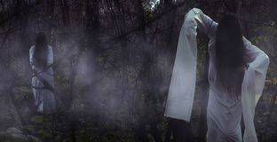Portrait of a dead girl on Halloween in a gloomy forest. royalty free stock image