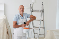 Portrait Of Decorator Painting Room. In House Royalty Free Stock Image