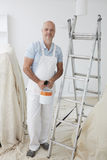 Portrait Of Decorator Painting Room Stock Photography
