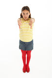 Portrait Of Defiant Young Girl Giving Thumbs Down Royalty Free Stock Photography
