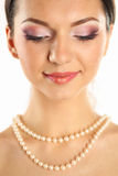 Portrait of a delicate woman wearing make up and jewelry Stock Photo