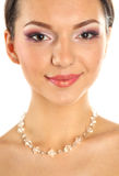 Portrait of a delicate woman wearing make up and jewelry Stock Image