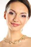 Portrait of a delicate woman wearing make up and jewelry Royalty Free Stock Photography