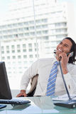 Portrait of a delighted businessman on the phone Stock Image