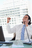 Portrait of a delighted businessman on the phone with the fist u Royalty Free Stock Photos