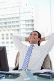 Portrait of a delighted businessman relaxing Stock Photos