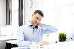 Portrait of a delighted businessman relaxing in his office. Stock Photos