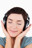 Portrait of a delighted woman listening Royalty Free Stock Image