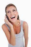 Portrait of a delighted woman making a phone call Royalty Free Stock Photo