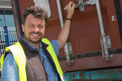 Portrait of delivery man smiling by truck Stock Photography