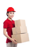 Portrait of delivery woman service happily delivering package to Stock Images