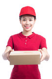 Portrait of delivery woman service happily delivering package to Royalty Free Stock Photos