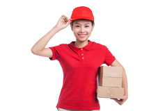 Portrait of delivery woman service happily delivering package to Royalty Free Stock Photo