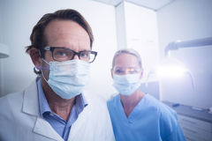 Portrait of dental assistant and dentist wearing surgical mask Royalty Free Stock Image
