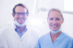 Portrait of dental assistant and dentist wearing surgical mask Stock Photos