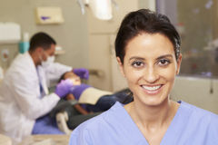 Portrait Of Dental Nurse In Dentists Surgery Stock Image