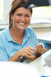 Portrait of dental technician. Dental technician milling a tooth for dentures Stock Photos