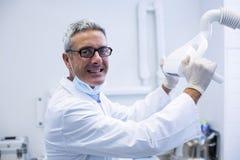 Portrait of a dentist adjusting light Royalty Free Stock Photo