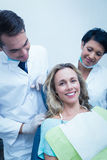 Portrait of dentist with assistant and female patient Royalty Free Stock Photo